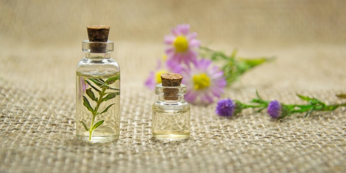 Essential oil bottles with flowers